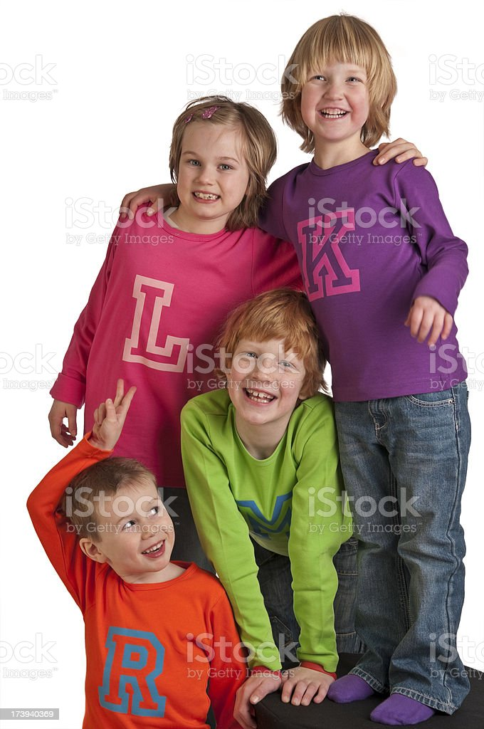 Group of four smiling children royalty-free stock photo