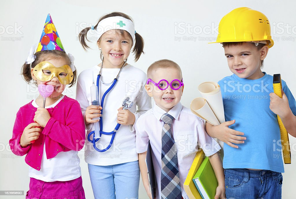 Group of four young children in career costumes Group of four children dressing up as professions Architect Stock Photo