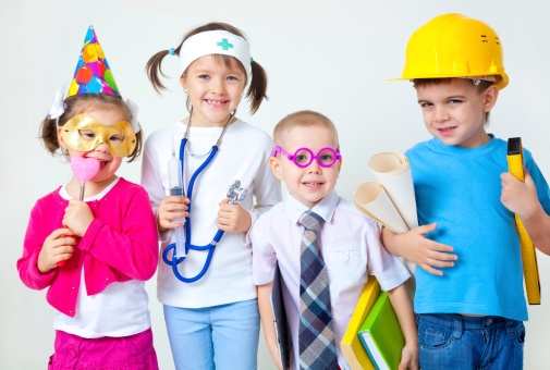 Group Of Four Young Children In Career Costumes Stock Photo - Download Image Now