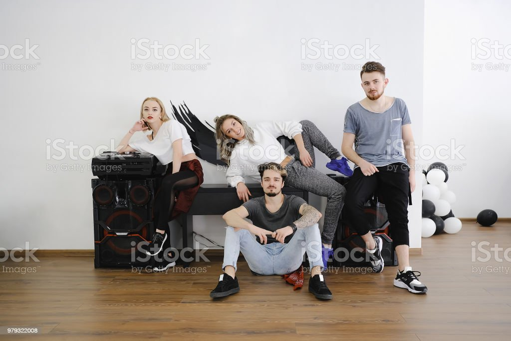Group of four young people posing stock photo