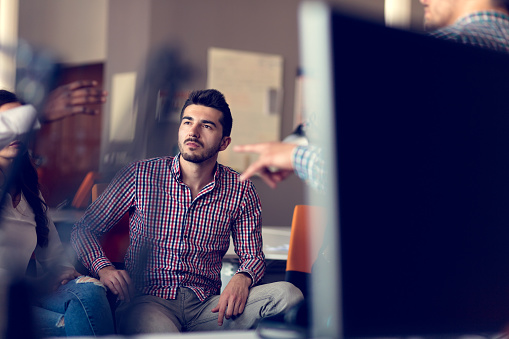 918746260 istock photo Group of freelancers are working on the new design project in the modern coworking space. 918682114