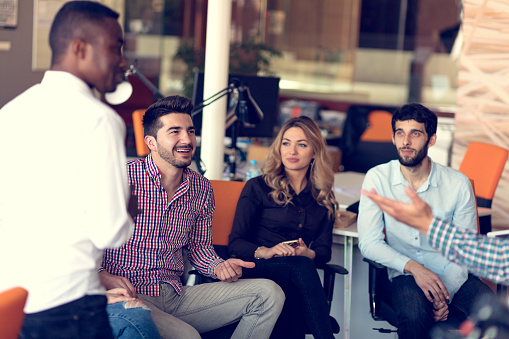 istock Group of freelancers are working on the new design project in the modern coworking space. 918746260