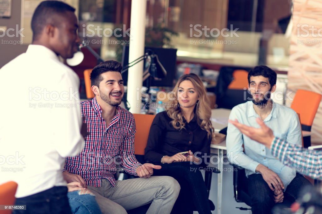 Group of freelancers are working on the new design project in the modern coworking space. stock photo