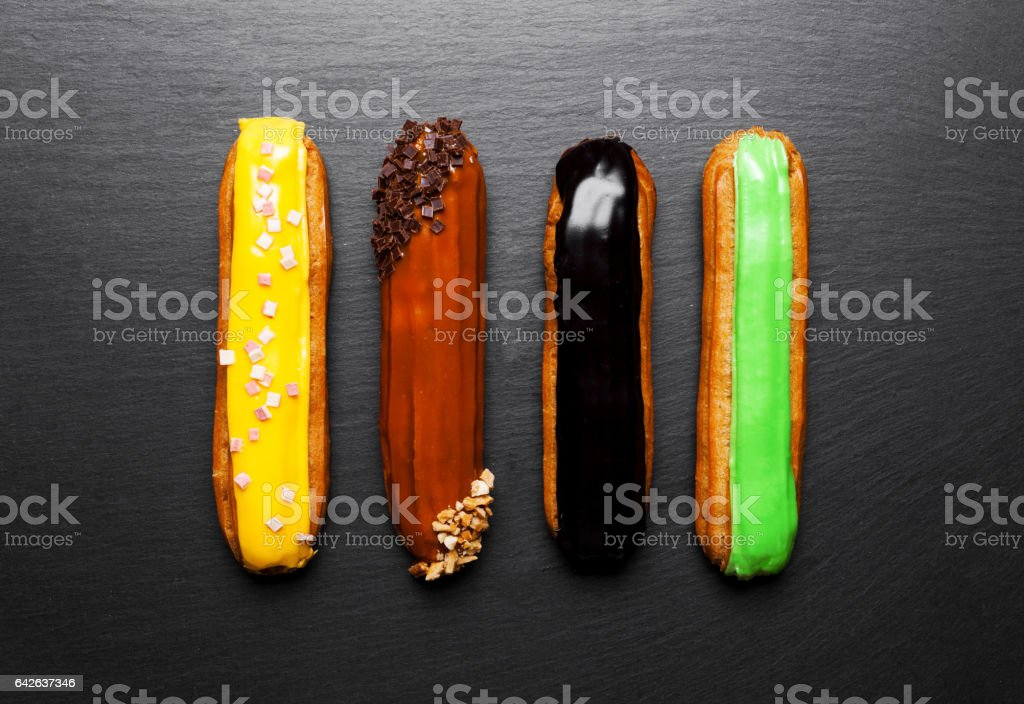 Group of french dessert Eclair on black background stock photo