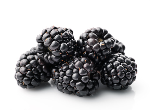 Group of fresh blackberries isolated on white background