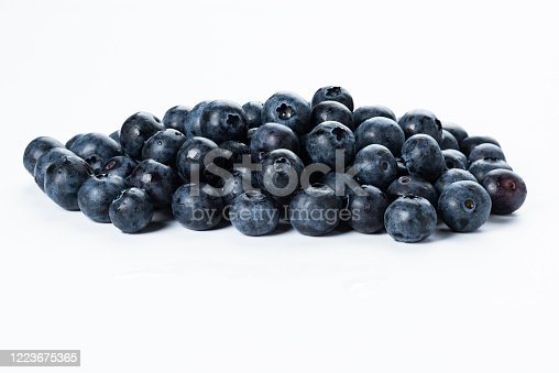 A group of fresh blue berries close-up, isolated on a white background.