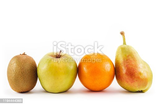 Group of fresh fruits isolated on white background. Kiwi, apple, orange and pear. Vegetarian, vegan, organic, bio and detox food. Concepts of nutrition, dietetics, health care and wellness.