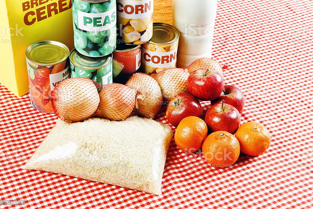 Group of fresh, packaged and canned groceries on red gingham royalty-free stock photo