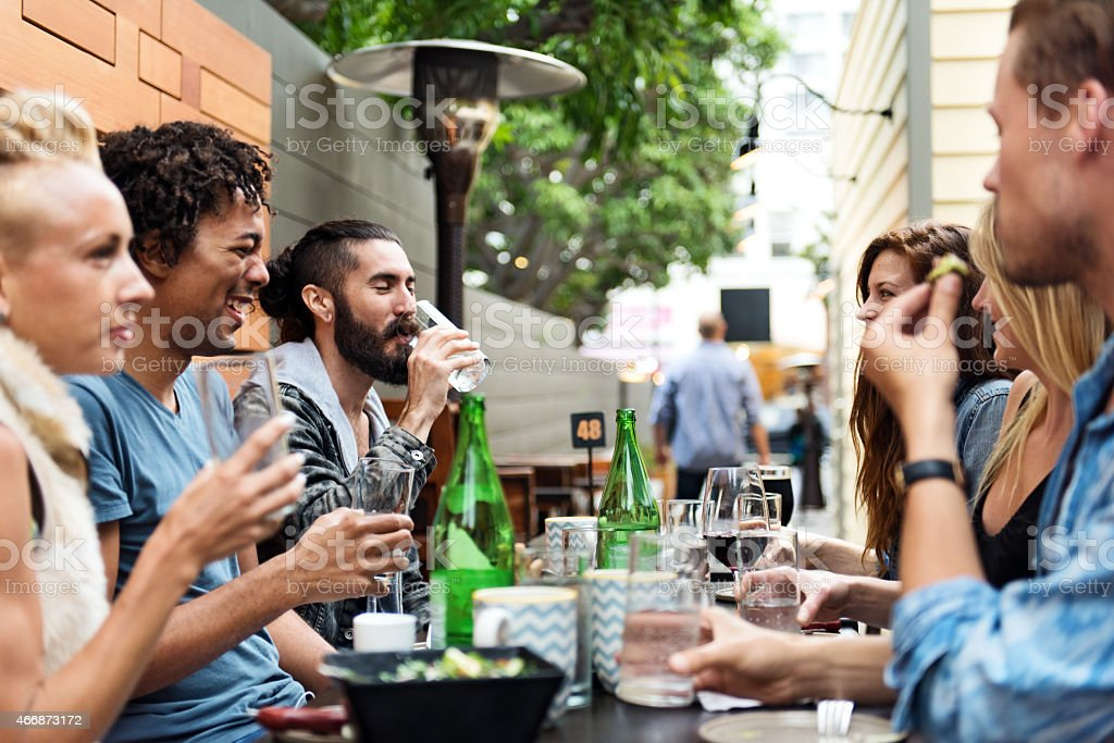 Group of friend eating outdoors stock photo