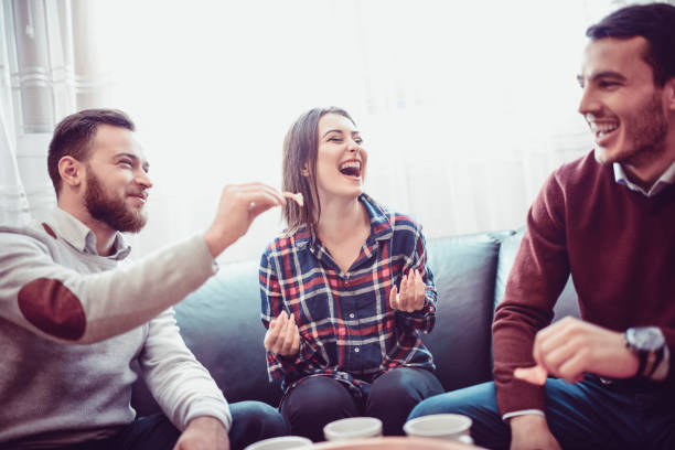 Group of Friend Eating Snacks, Conversing and Having Fun Time Together stock photo