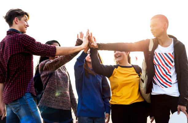 Group of friends all high five together support and teamwork concept Group of friends all high five together support and teamwork concept teenagers only stock pictures, royalty-free photos & images