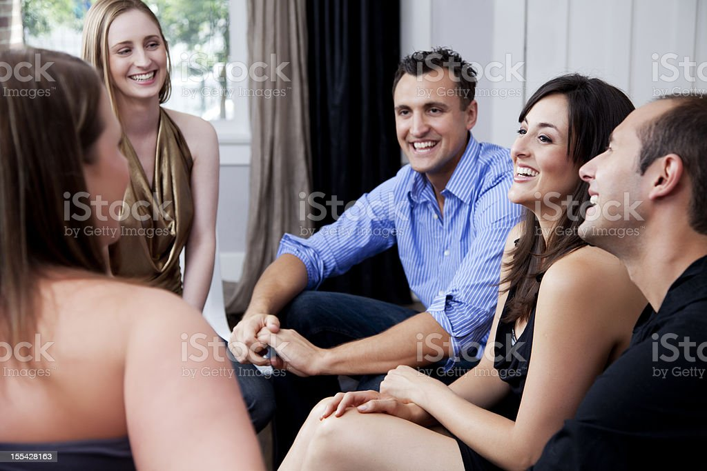Group of friends at a house party royalty-free stock photo