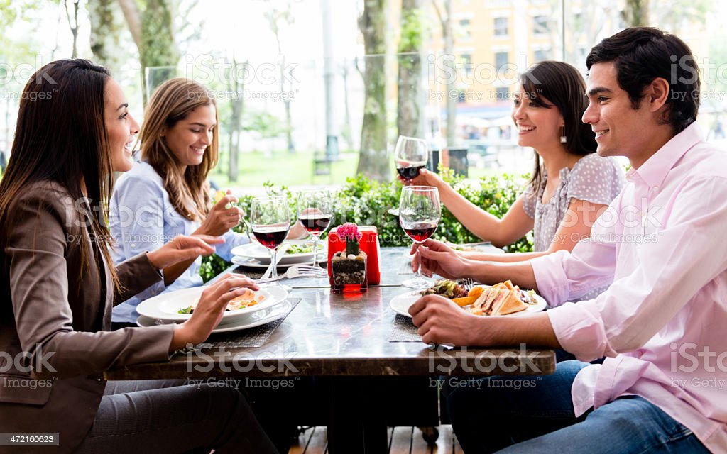 Group of friends at a restaurant stock photo