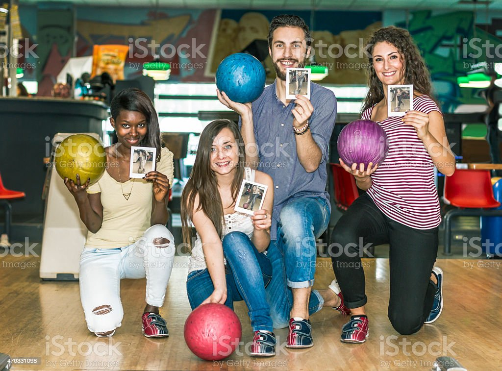 Group of friends at bowling stock photo