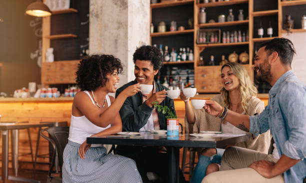 Group of friends at cafe having coffee together stock photo