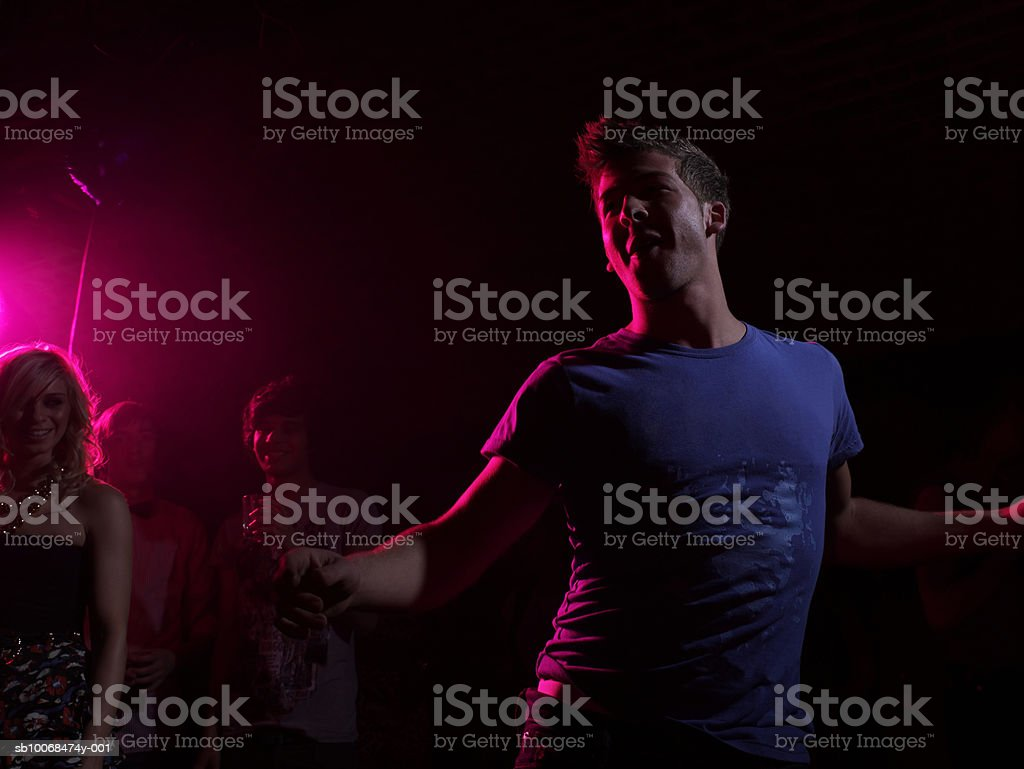 Group of friends at party in night club royalty-free stock photo