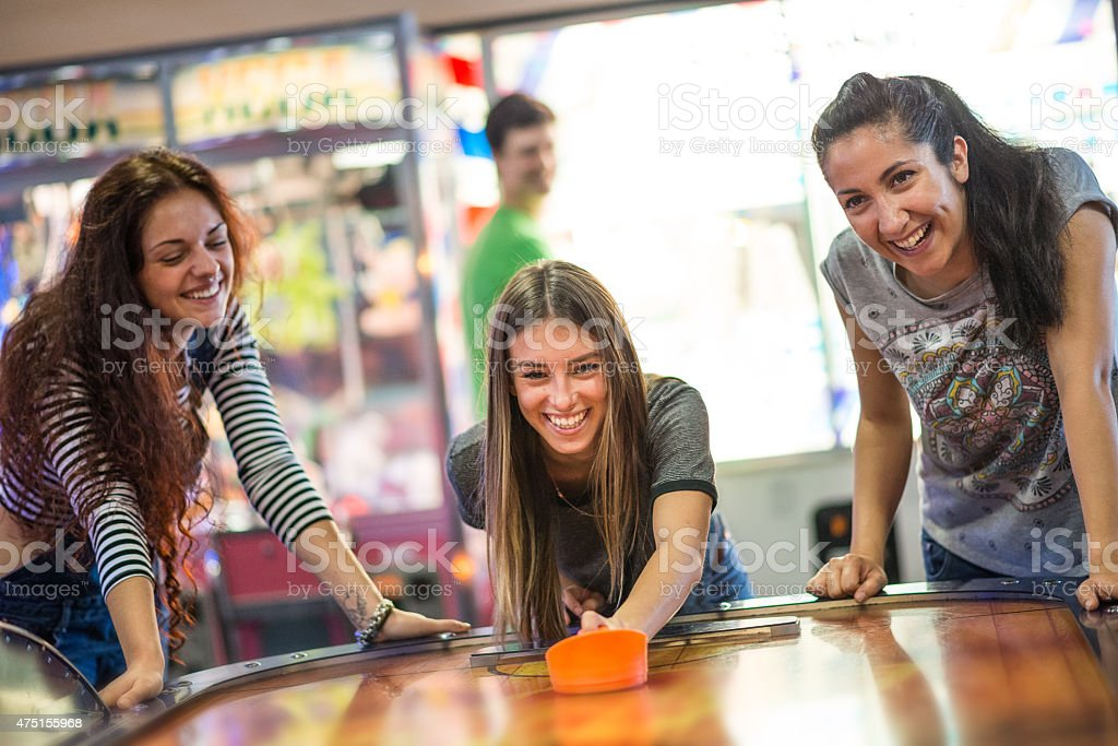 Group of friends at the amusement arcade stock photo