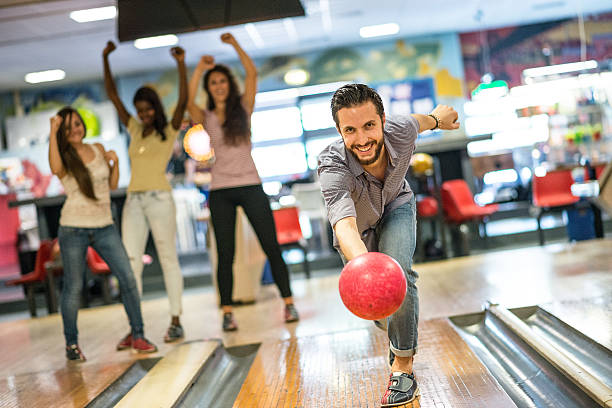 Group of friends at the bowling stock photo
