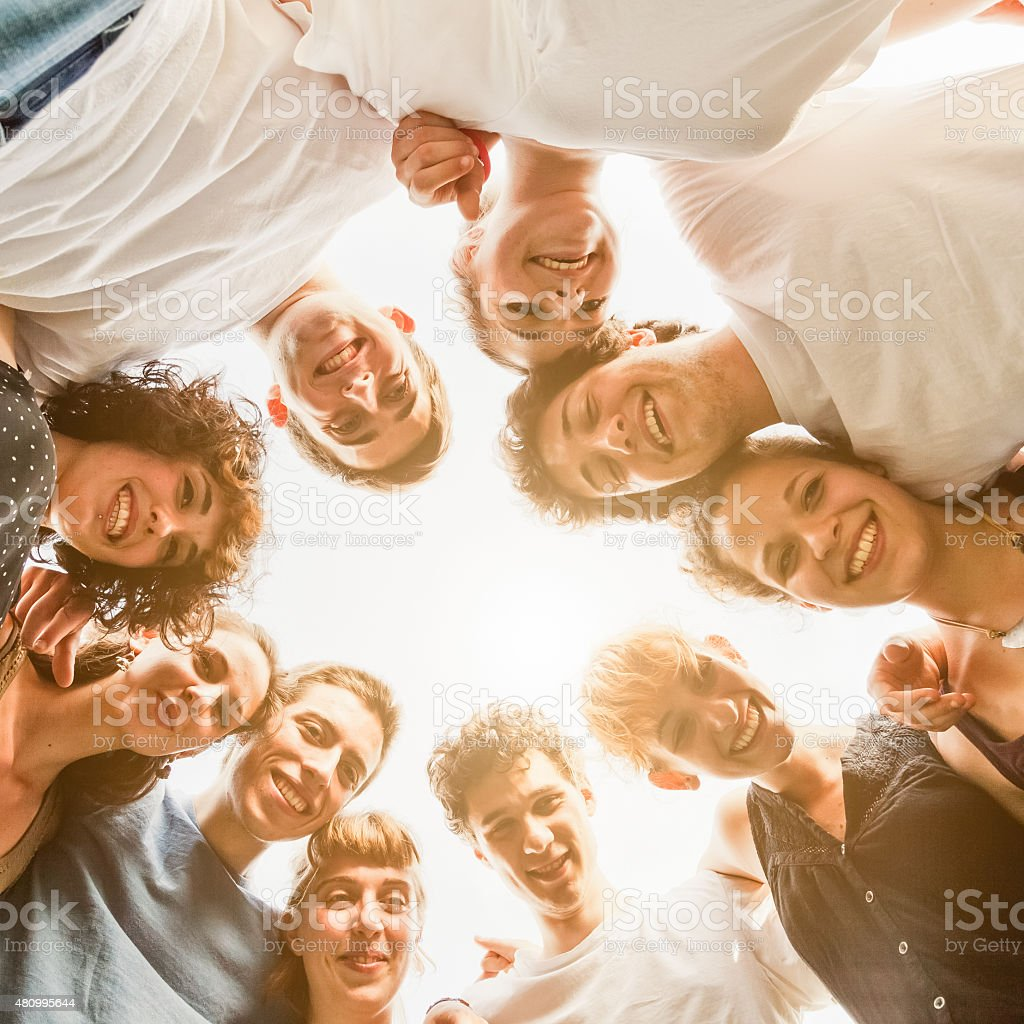 Group of friends at the park. View from below stock photo