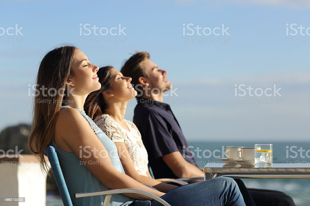 Group of friends breathing fresh air in a restaurant stock photo