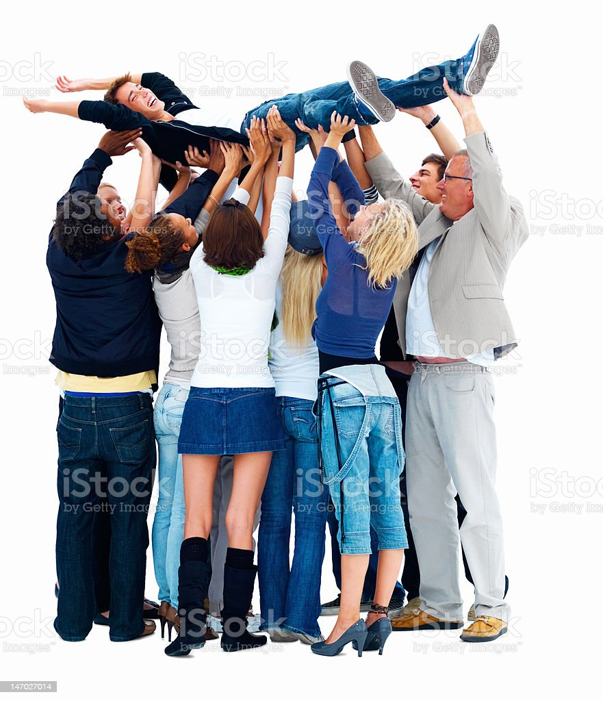 Group of friends carrying a young man royalty-free stock photo