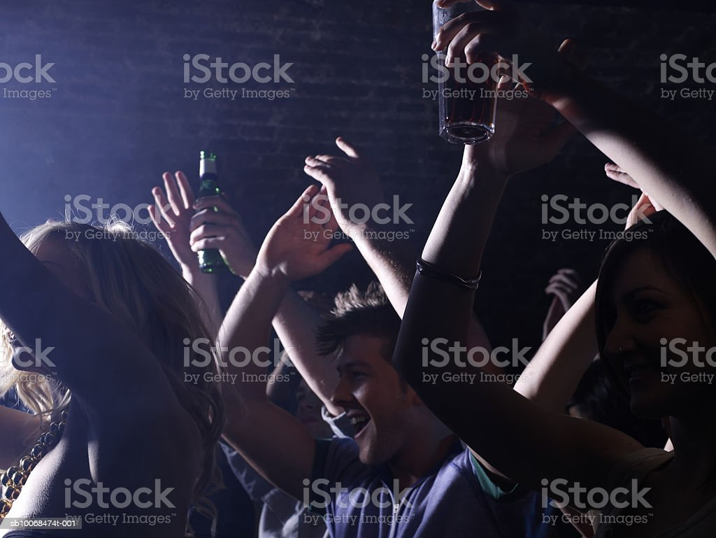 Group of friends celebrating at party in night club royalty free stockfoto