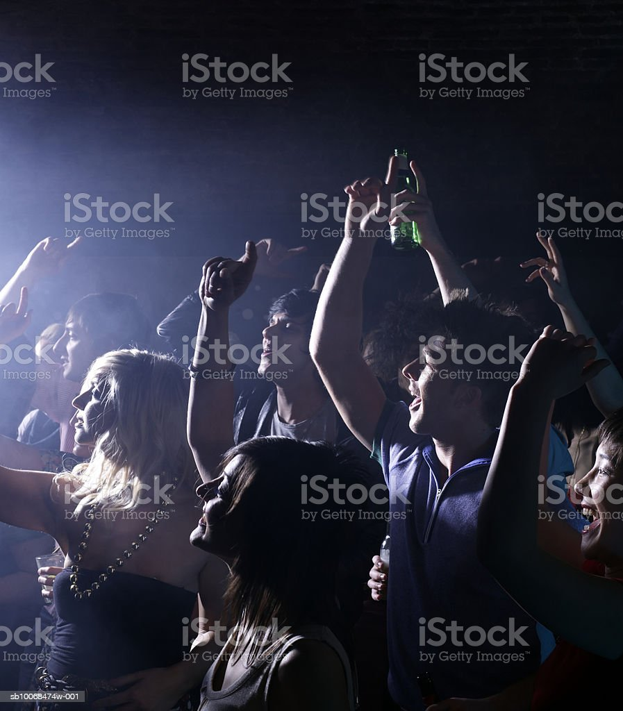 Group of friends celebrating at party in night club royalty-free stock photo