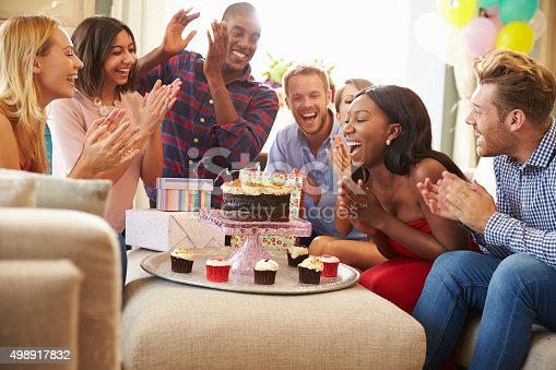 istock Group Of Friends Celebrating Birthday At Home Together 498917832
