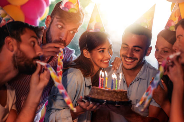 Group of friends celebrating birthday together stock photo
