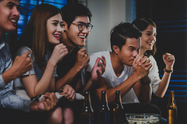 Group of friends celebrating sports victory stock photo
