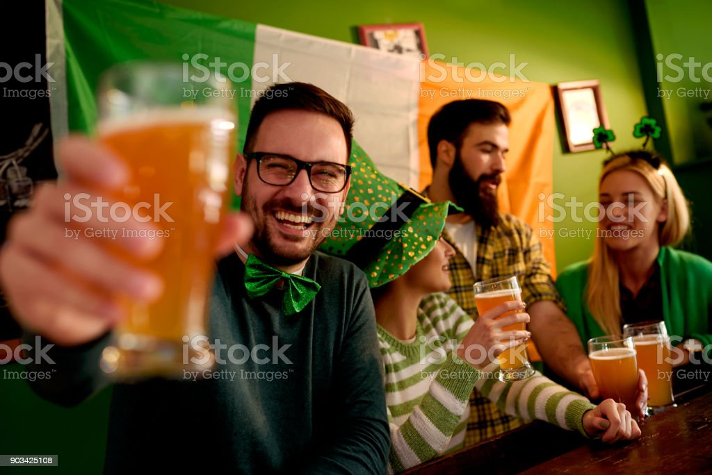 Group of Friends Celebrating St Patrick's Day at Beer Pub stock photo