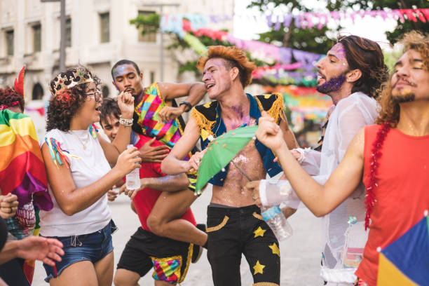 Group of friends dancing on the street Carnival - Celebration Event, Colors, Costume, Cultures, Brazil gay pride parade stock pictures, royalty-free photos & images