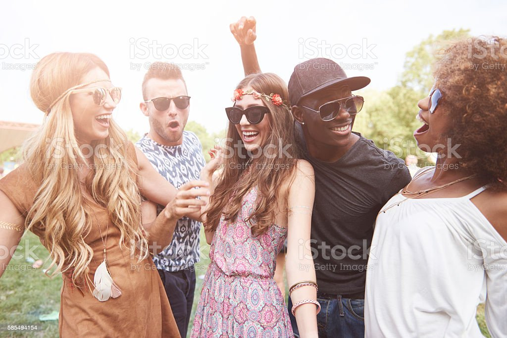Group of friends dancing outdoors stock photo
