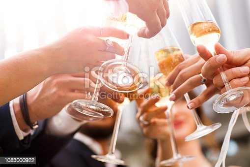 istock Group of friends drinking and toasting  champagne at brewery bar restaurant - Friendship concept with young people having fun together   Focus on middle pint glass 1083000922