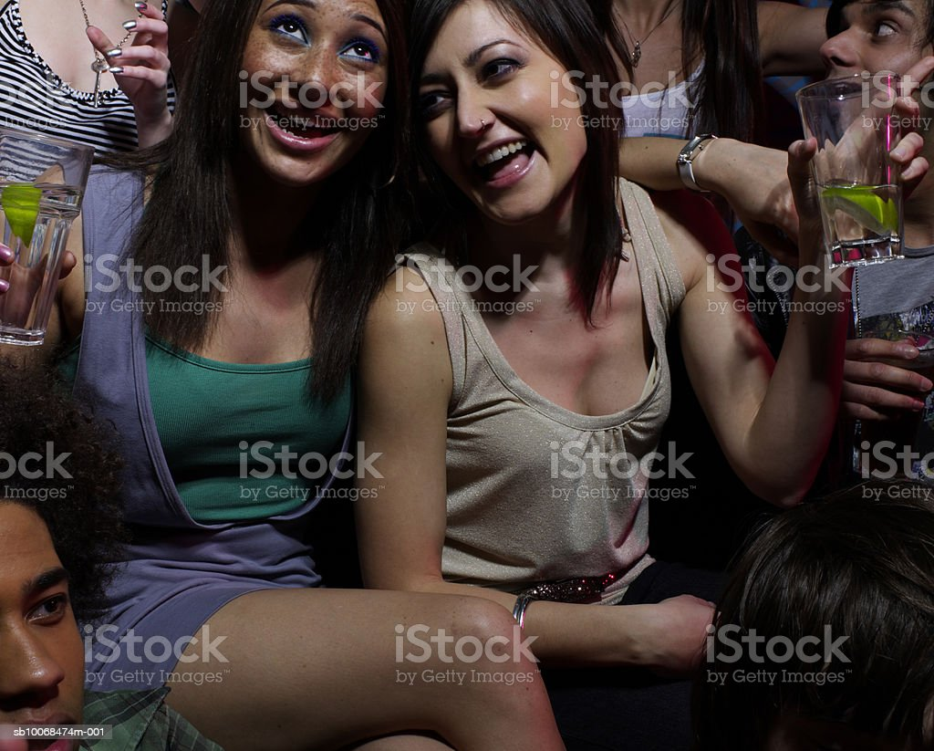 Group of friends drinking at party royalty-free stock photo