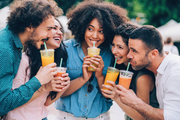 Group of friends drinking smoothies stock photo