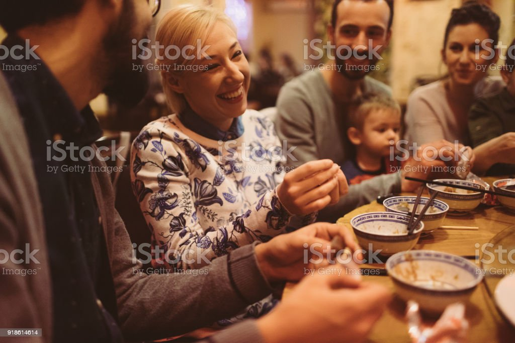 Group of friends eating in a Chinese restaurant stock photo