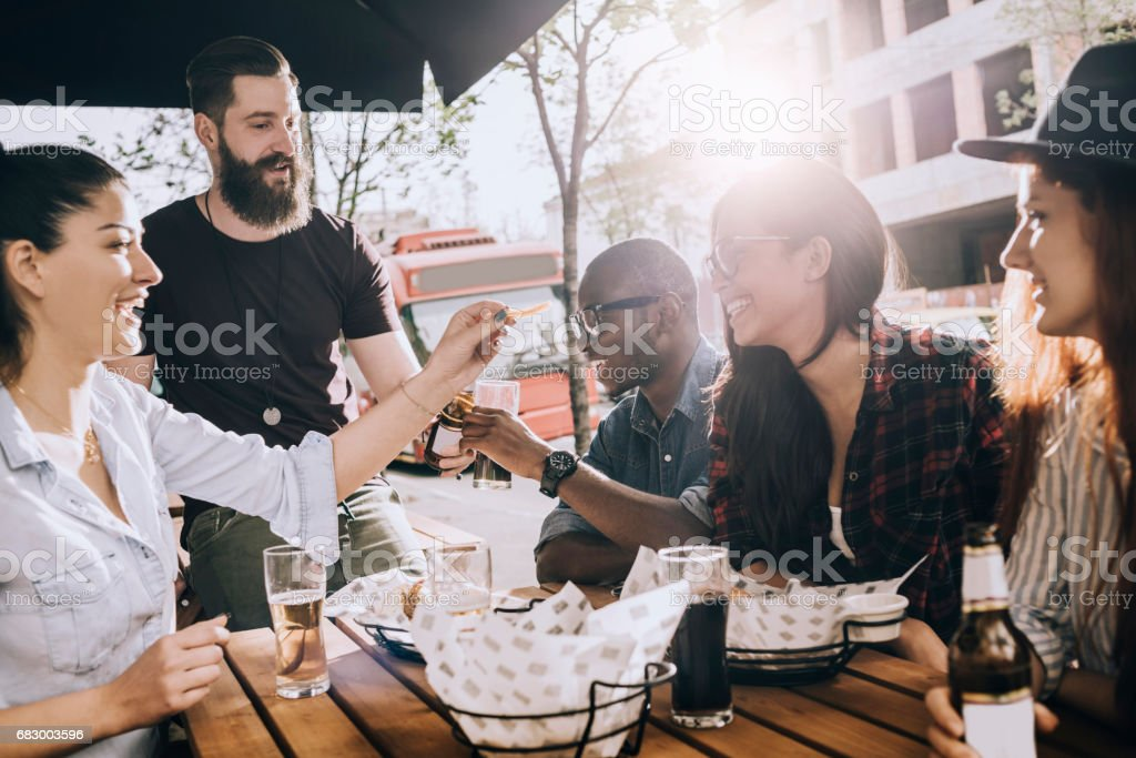 group of friends eating outdoors and having fun foto de stock royalty-free