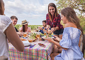 group of friends enjoy a happy summer day outdoor having a garden party