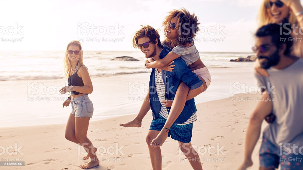 Group of friends enjoying a day at the beach stock photo