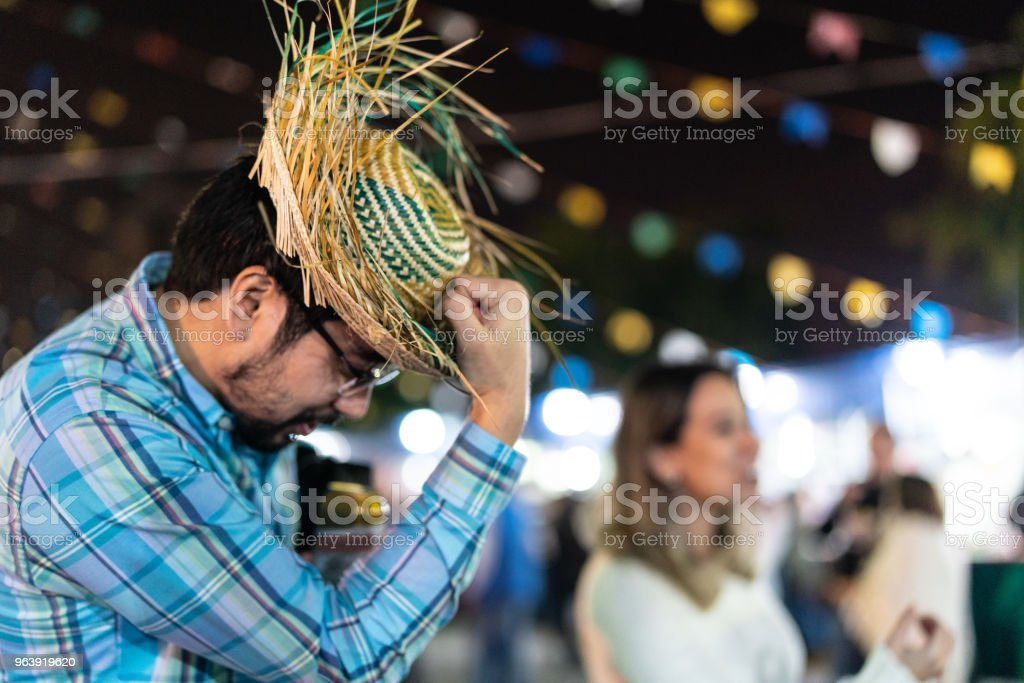 Group of friends enjoying a great time together in the famous Brazilian Junina Party (Festa Junina) - Caipira style - Royalty-free Adult Stock Photo