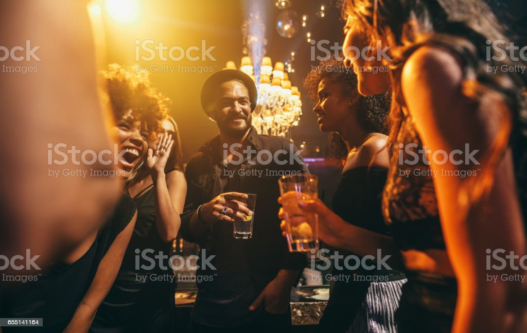 Group of friends enjoying a party at pub stock photo