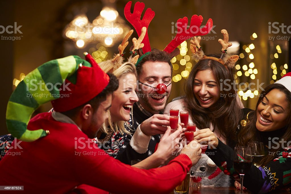 A group of friends enjoying Christmas drinks stock photo