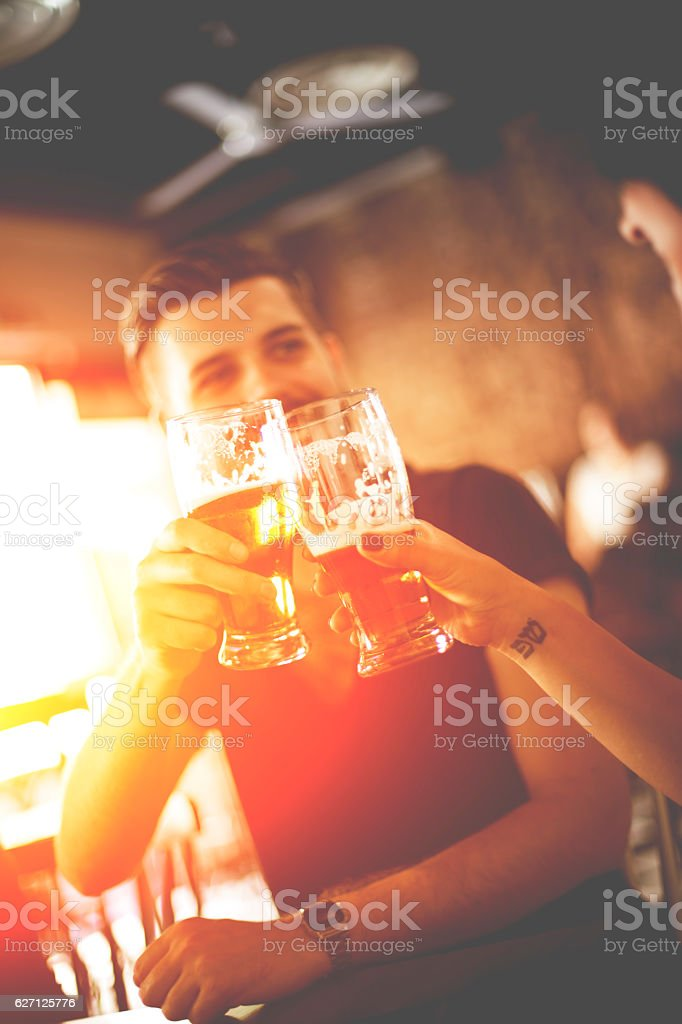 Group Of Friends Enjoying Drink stock photo