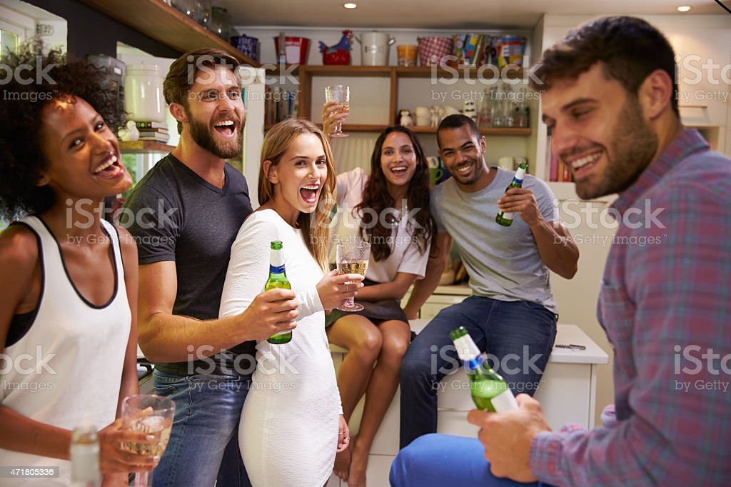 Group Of Friends Enjoying Drinks Party At Home stock photo