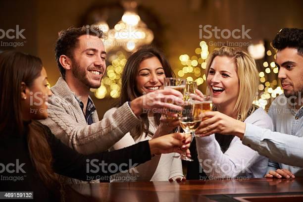 Group of friends enjoying evening drinks in bar picture id469159132?b=1&k=6&m=469159132&s=612x612&h=uzsmg1rt7nye8bm9 rmudi64jk7u5ubejfz2lewsduk=