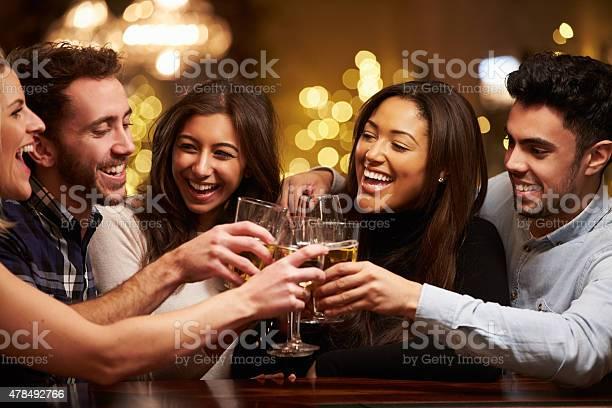 Group of friends enjoying evening drinks in bar picture id478492766?b=1&k=6&m=478492766&s=612x612&h=wj9x9lplrvtqtpqkzkuxvwtthq67r3hj0gw5tcllsdi=