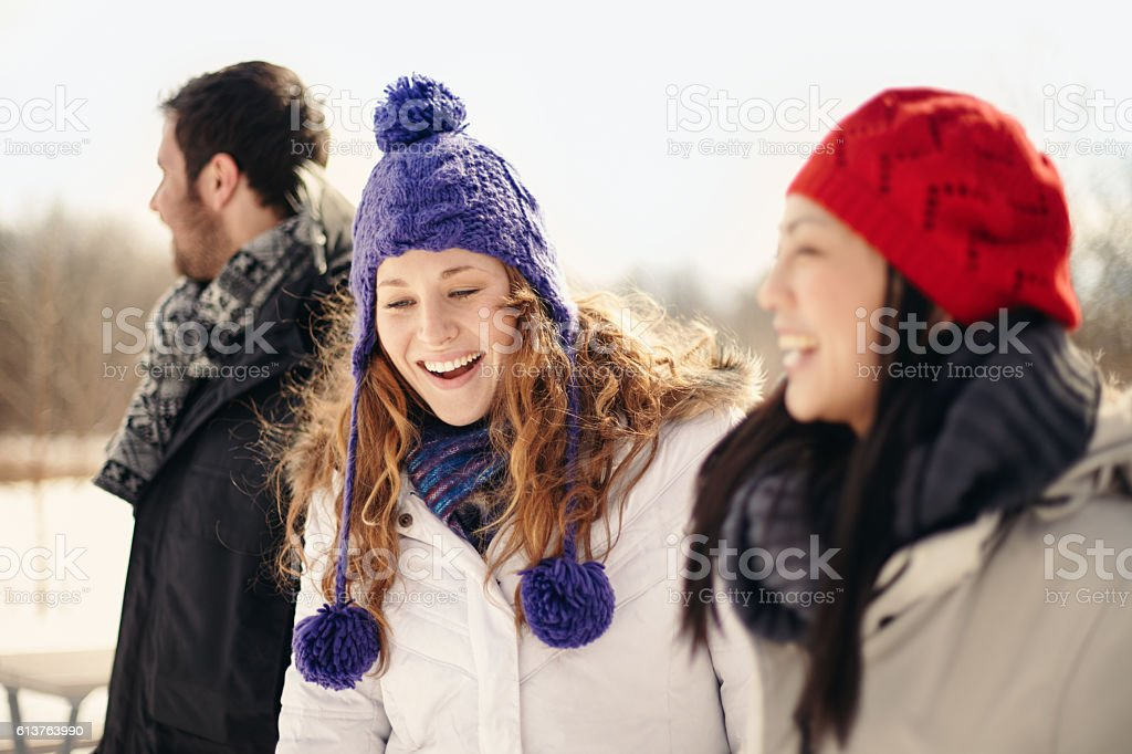Group of friends enjoying hanging out in winter stock photo
