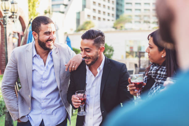 Group of friends enjoying happy hour at an open bar stock photo