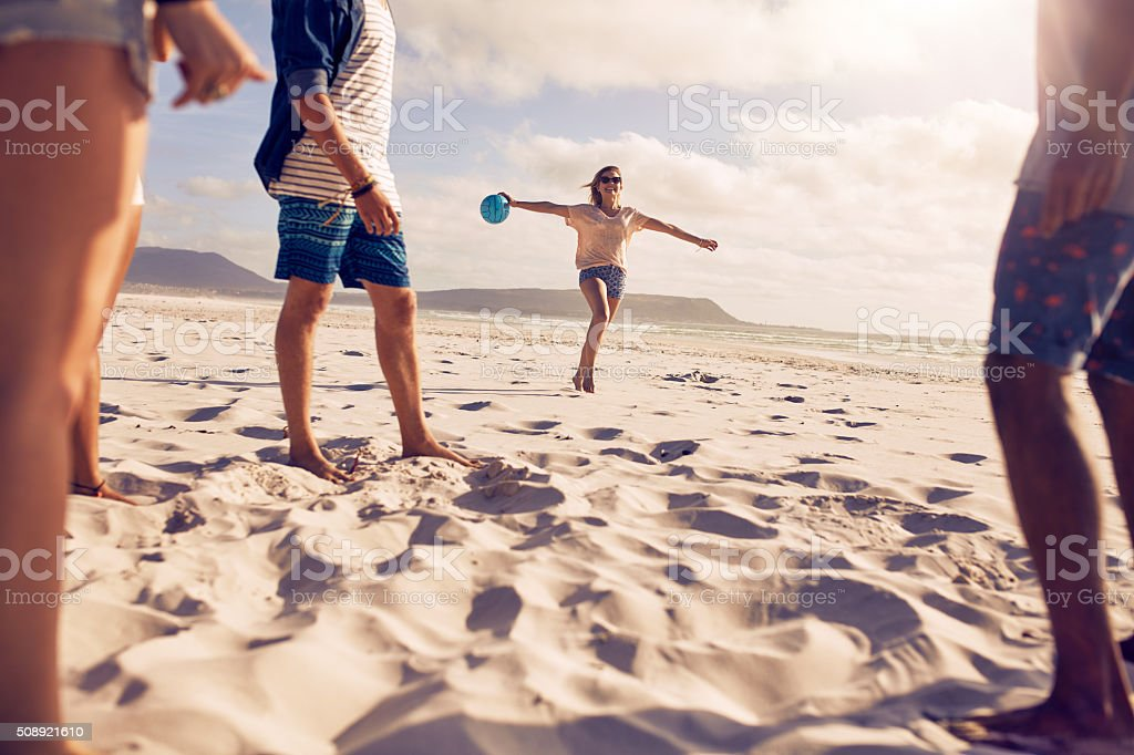 Group of friends enjoying holiday on the beach stock photo
